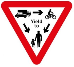 "The golden rule is ""Yield to the most vulnerable on the road"". (http://www.portlandtoportland.org/)"