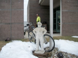 A statue of Sergeant James Miller guards our bikes while we stop for bathrooms.