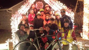 18 bicyclists crowded into the Candy Cane Hut